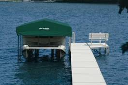 Pier Pleasure canopies - Keeping your investment covered! Click on photo to see more boat lift canopy photos.